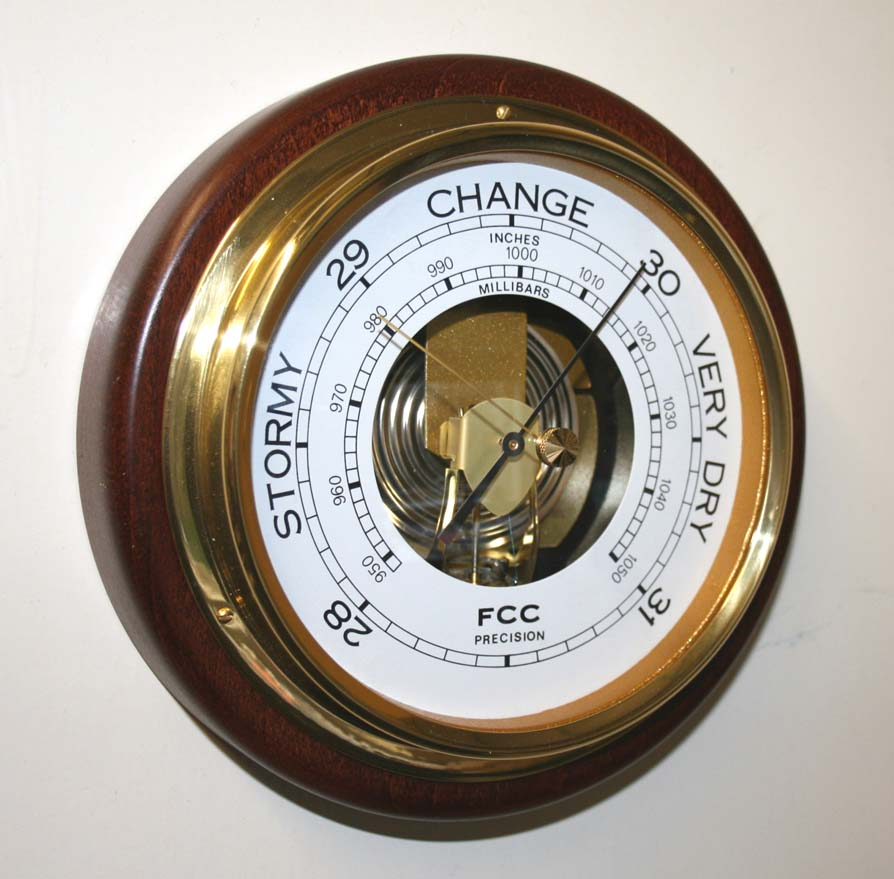 Barometer mounted on wood