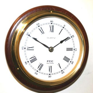 Clock mounted on wood