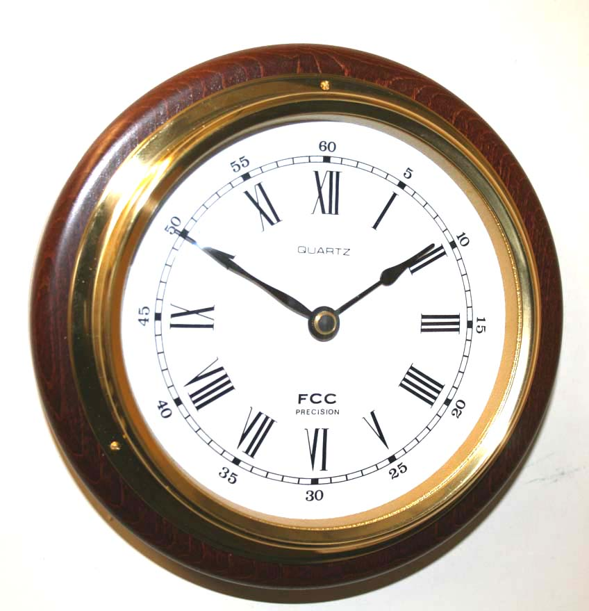 Clock mounted on wood