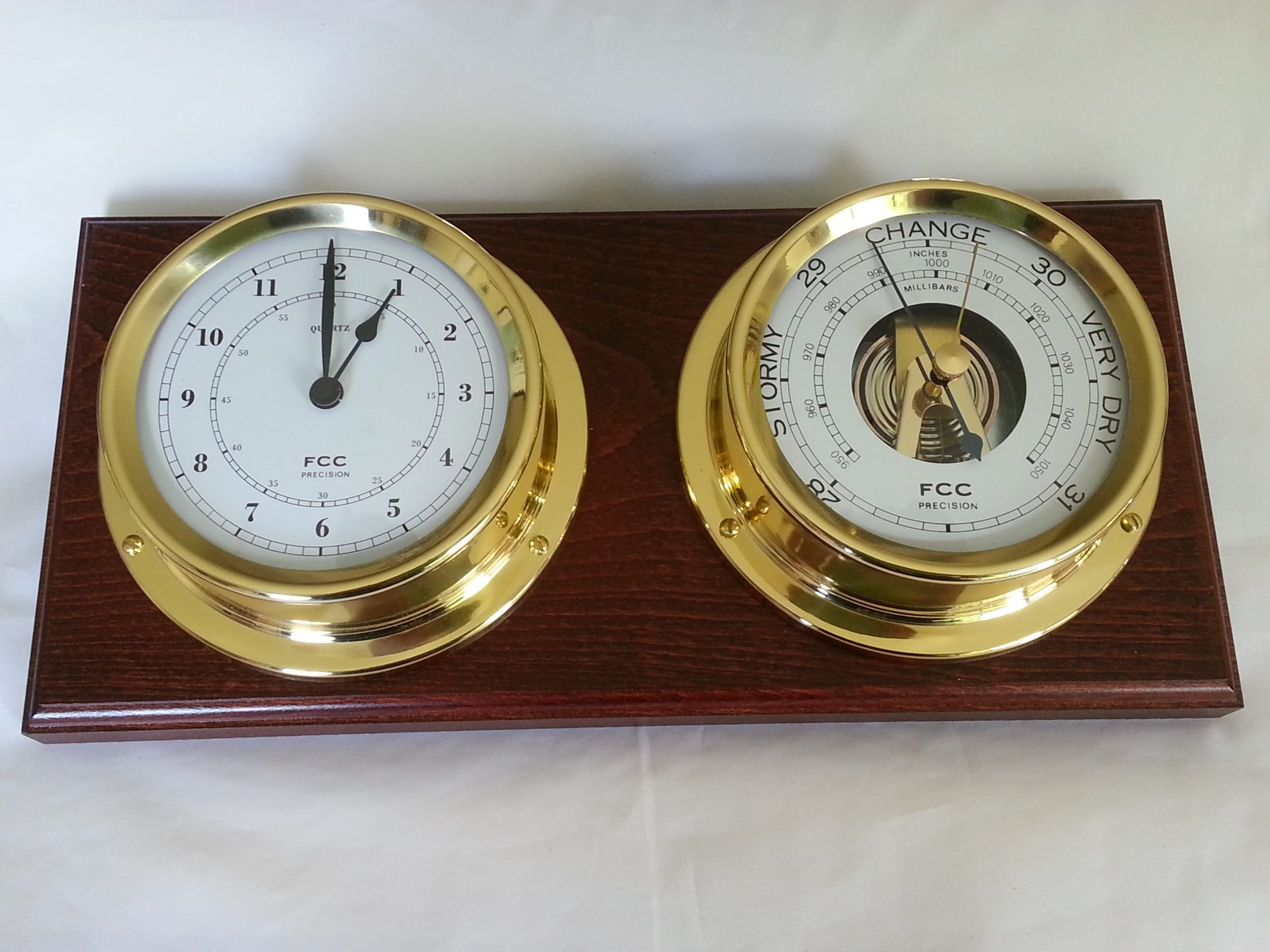 Clock and Barometer mounted on plinth
