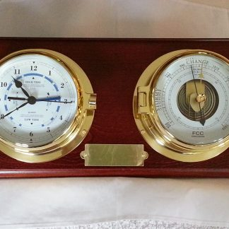 Brass time and tide clock and barometer